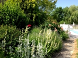 The English-style cottage garden behind La Ferme